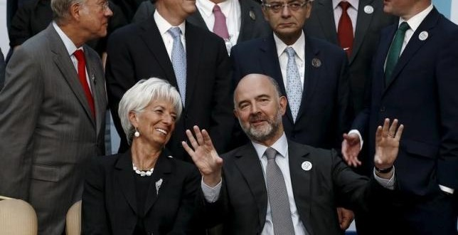 European Economic and Financial Affairs Commissioner Pierre Moscovici and International Monetary Fund (IMF) Managing Director Christine Lagarde speak as they wait for a group photo of the G20 Finance Ministers and Central Bank Governors in Ankara, Turkey, September 5, 2015. REUTERS/Umit Bektas